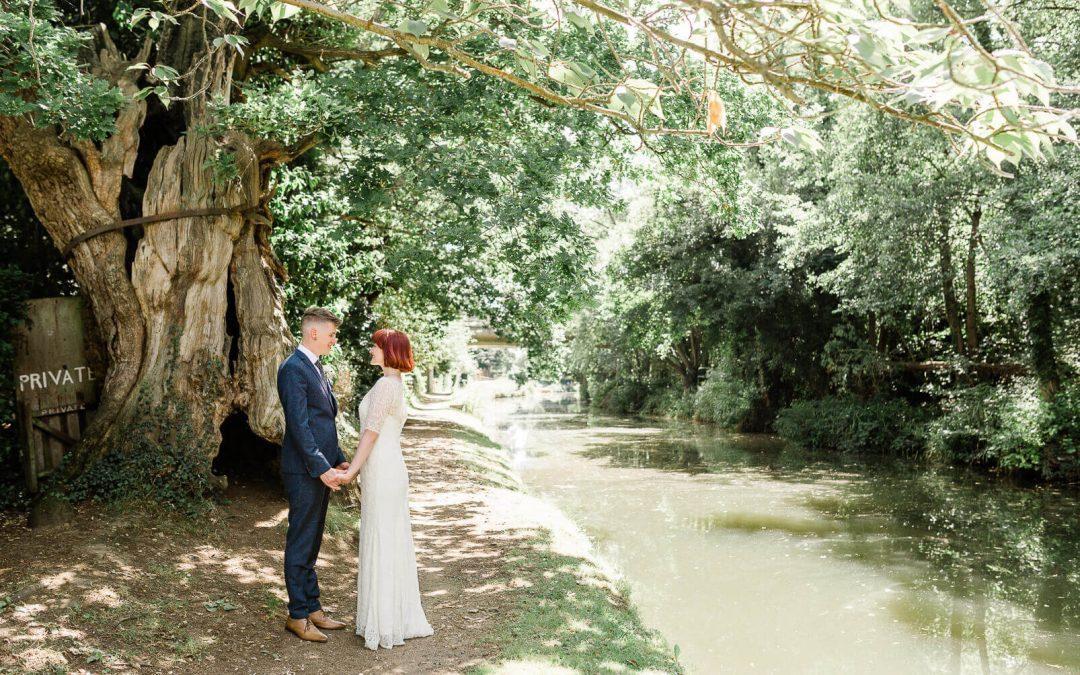 Guildford canals couple portrait near St Luke's Church wedding