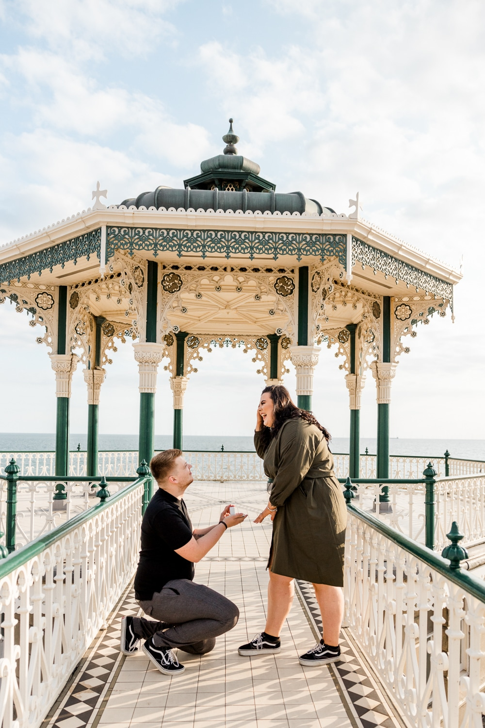 proposal at Brighton Bandstand along seafront with photographer