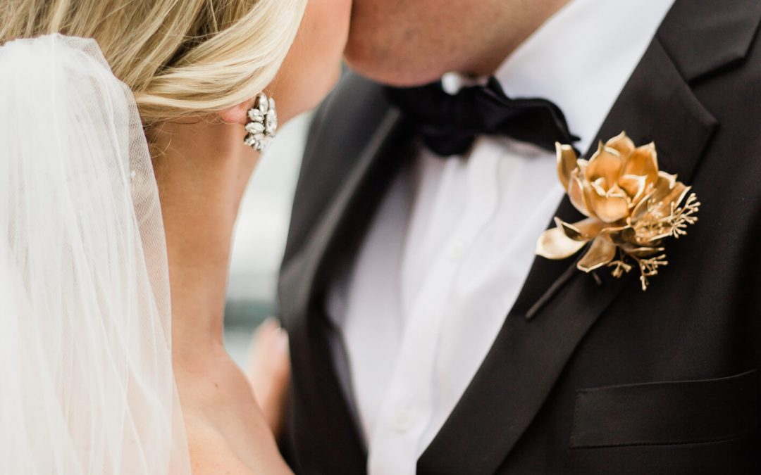 wedding day inspiration gold dipped rose buttonhole on groom