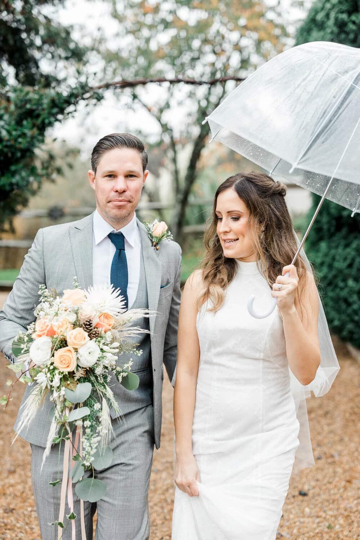 Brookfield Barn rainy wedding clear umbrella