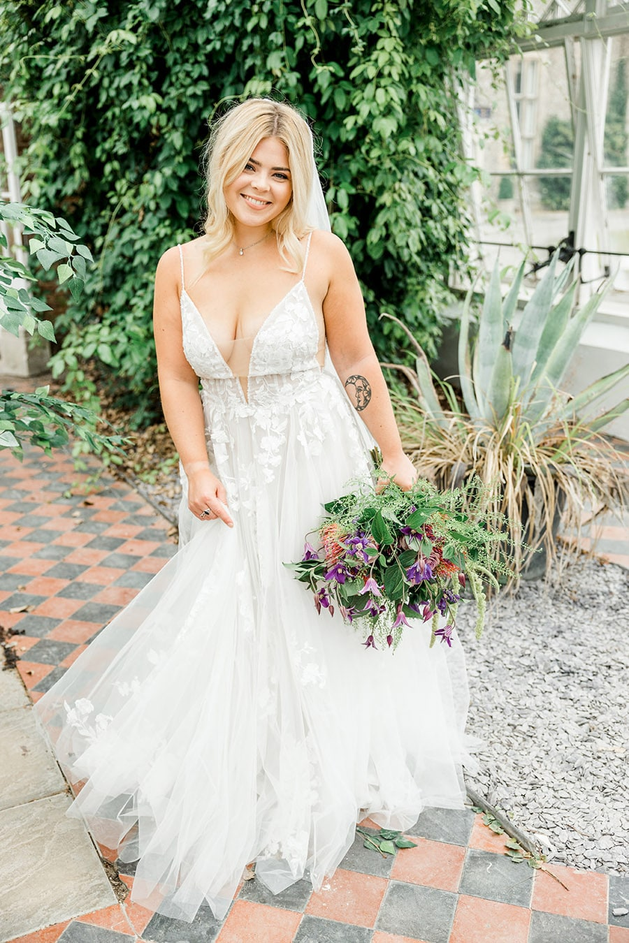 Conservatory bridal portraits at Slindon College wedding