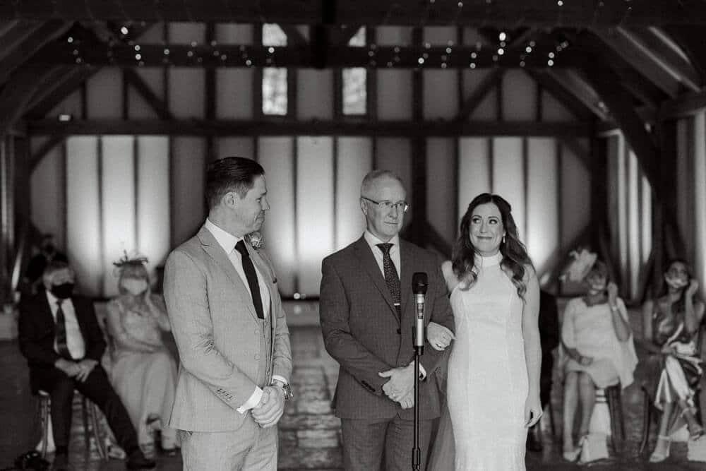 Indoor ceremony at Brookfield Barn wedding photos