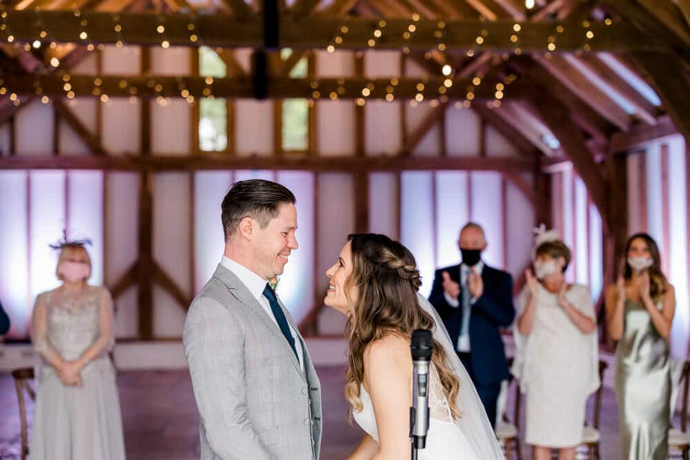 Intimate indoor ceremony at Brookfield Barn wedding photos