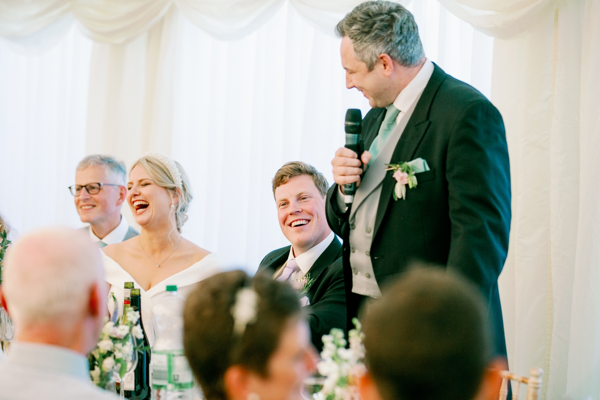Best man speech in marquee with Eastbourne wedding photographer