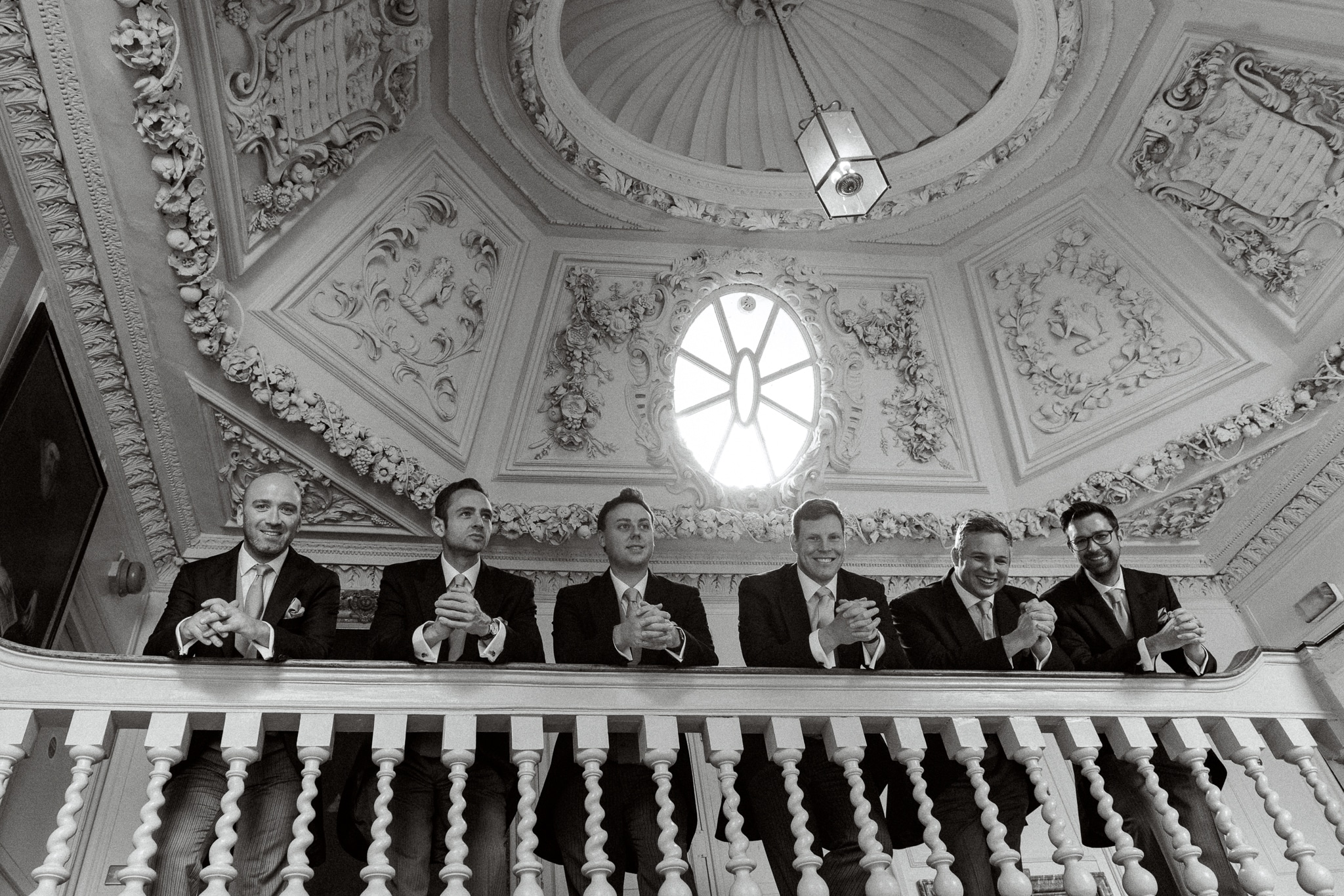 Bridal party on stairs with East Sussex wedding photographer