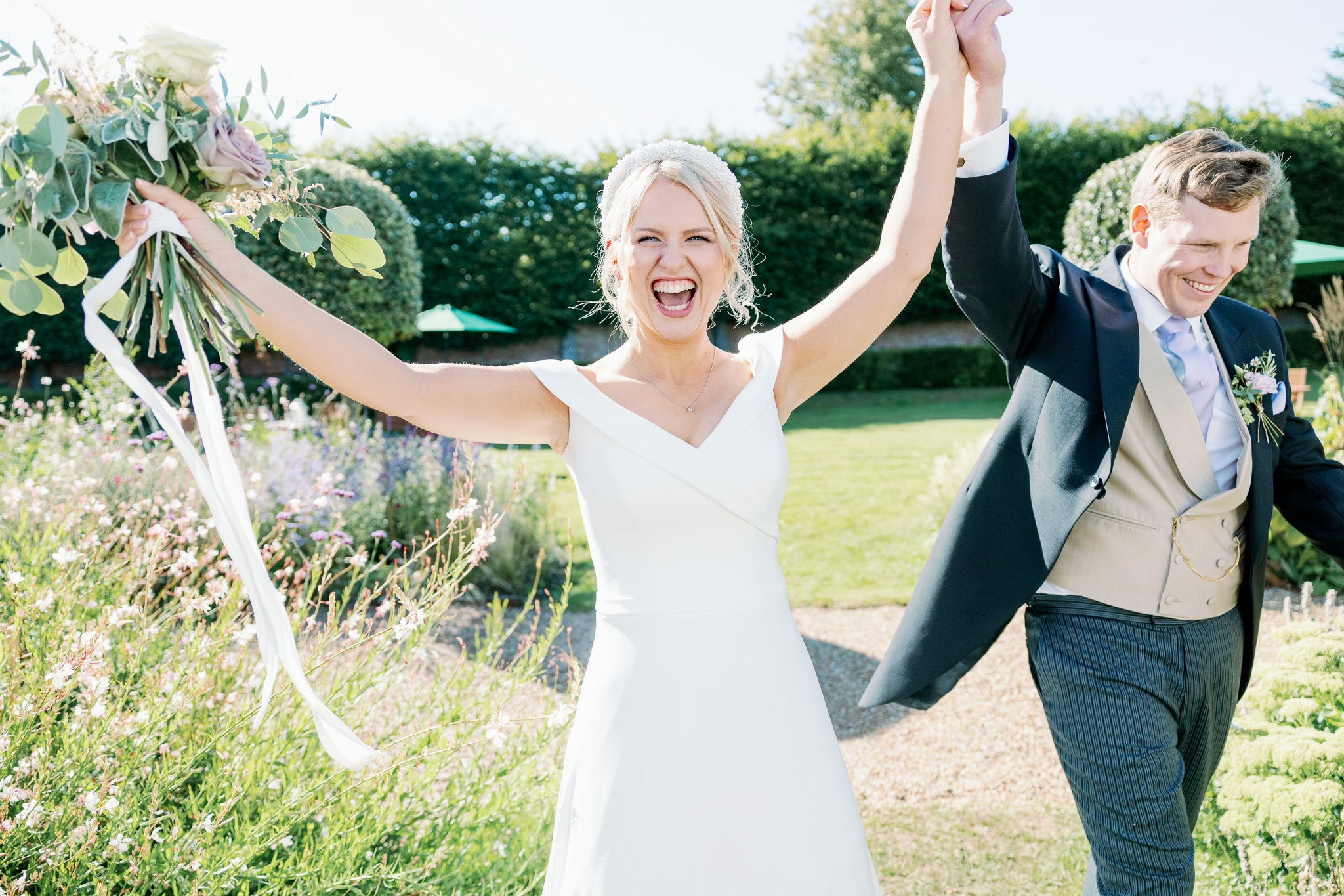 Bride and groom entrance to marquee with award-winning wedding photographer in Sussex