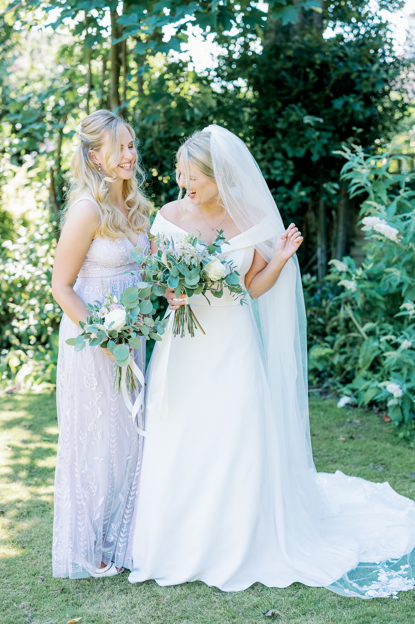 Bride and maid of honour with East Sussex wedding photographer