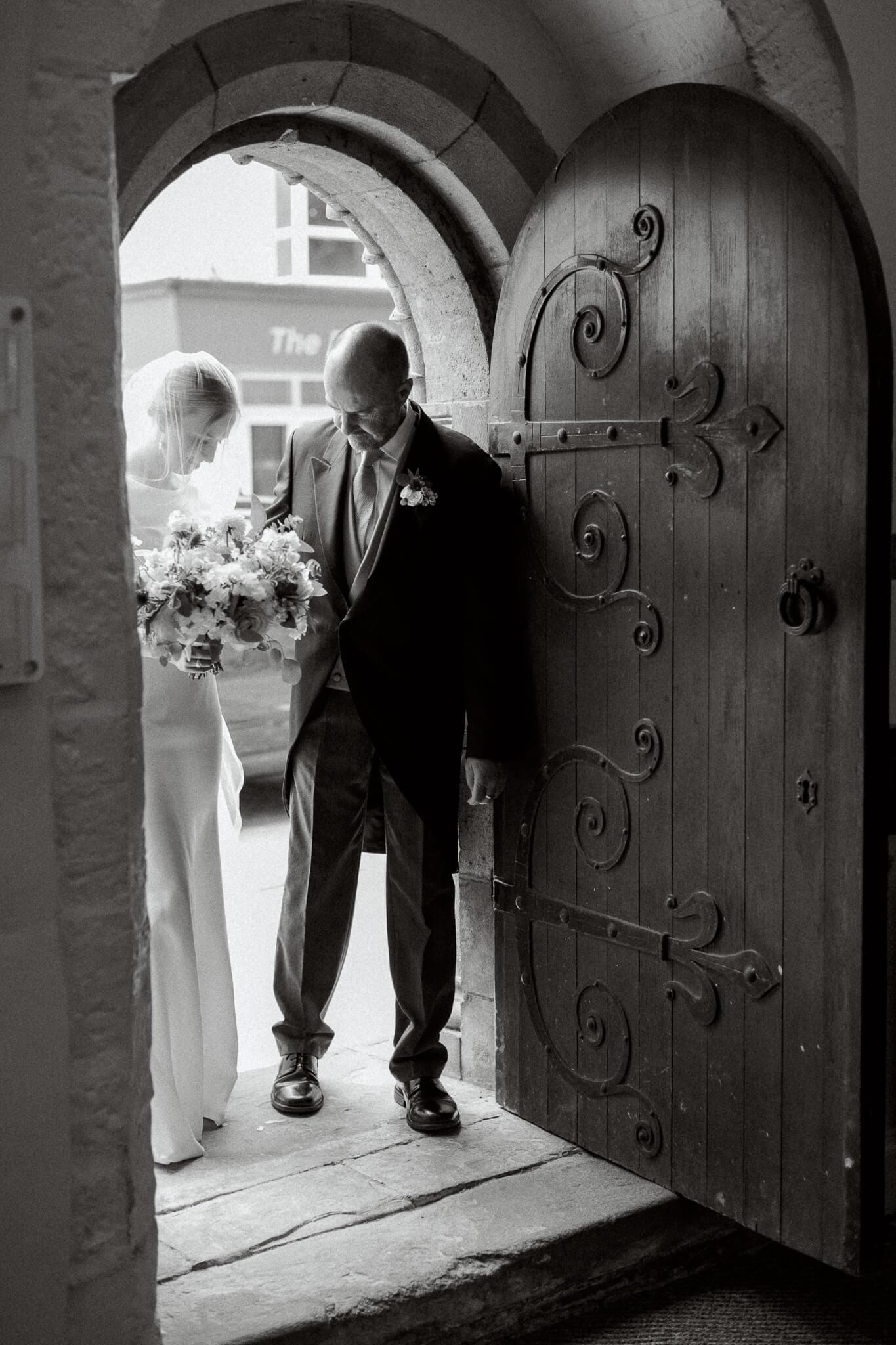 Bride entering St Ebbs Church in Oxfordshire wedding