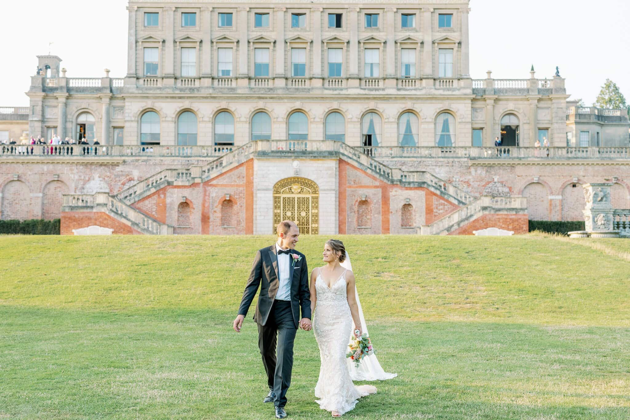 Cliveden House wedding photographer with couple and house in background