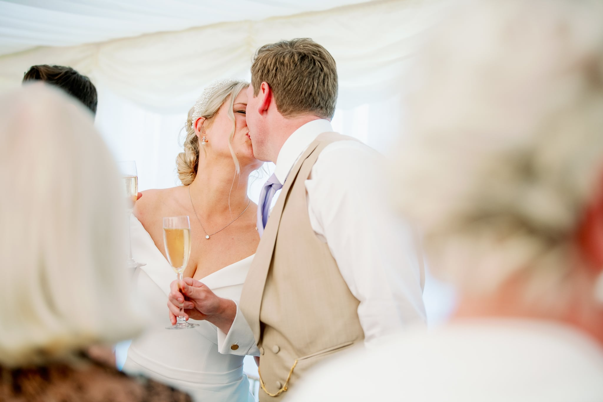 East Sussex Marquee wedding venue with couple kissing