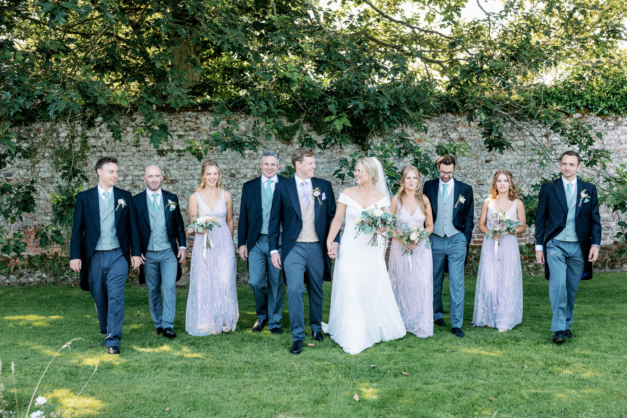 Full Bridal party in walled garden at Brickwall House