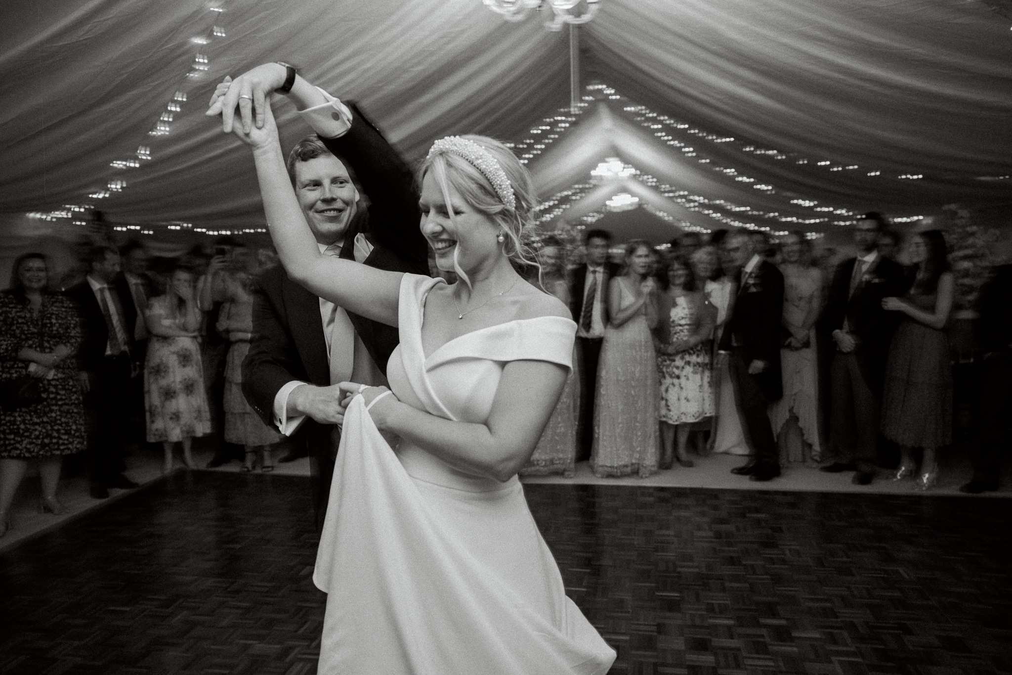 Hastings wedding photography of first dance in Brickwall House wedding marquee