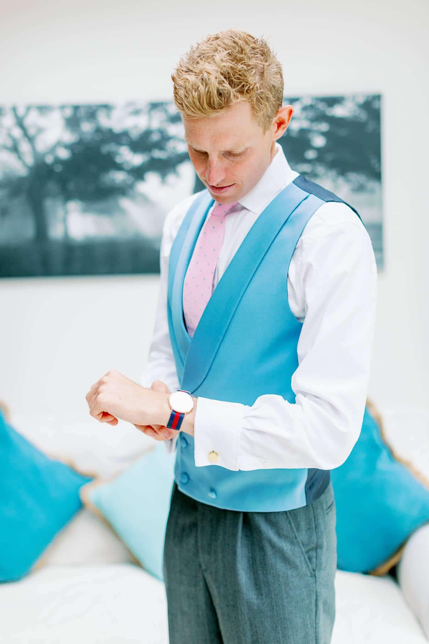 Lains Barn wedding groom with watch