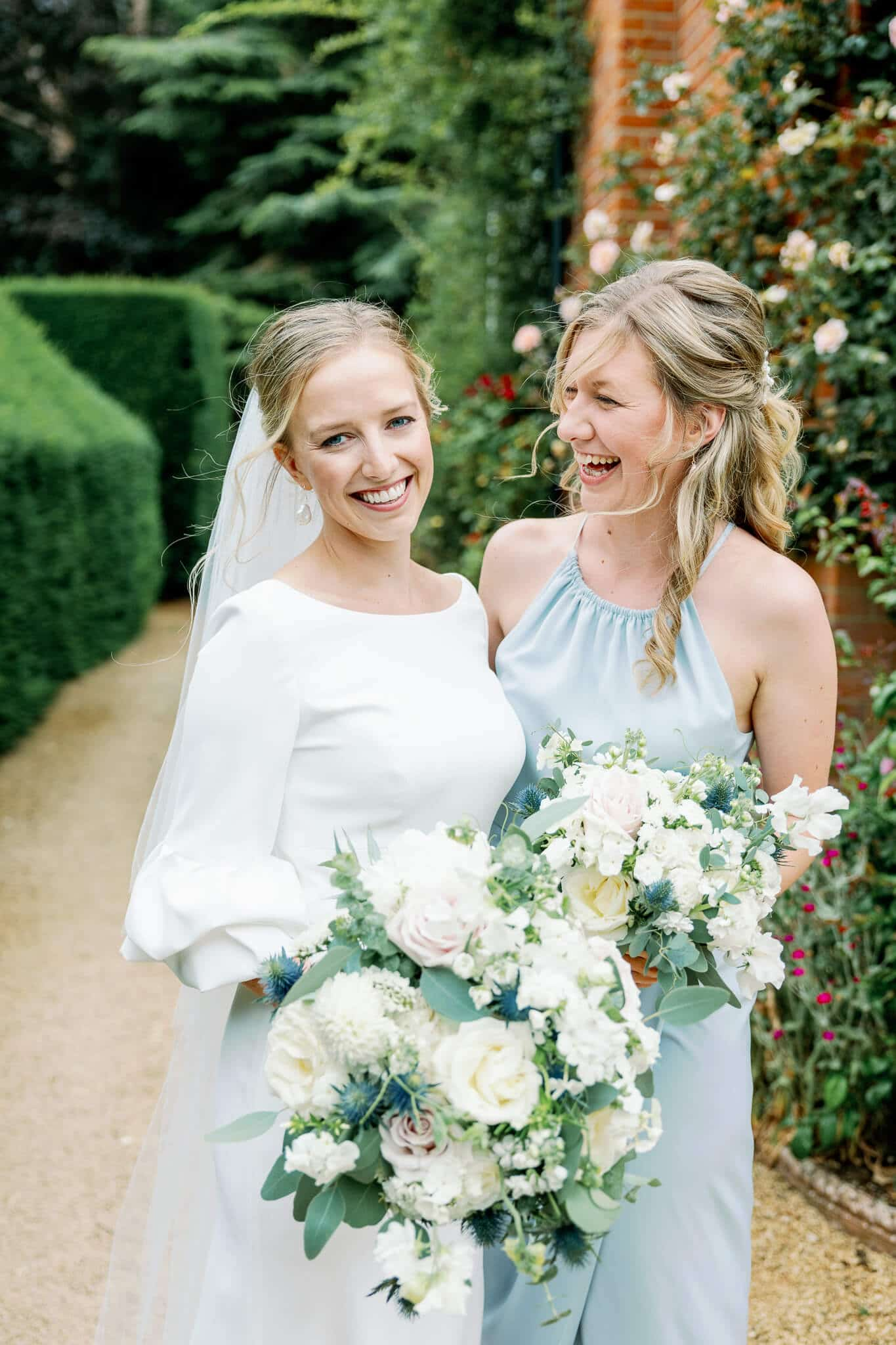 Lains Barn wedding photos of bride with maid of honour