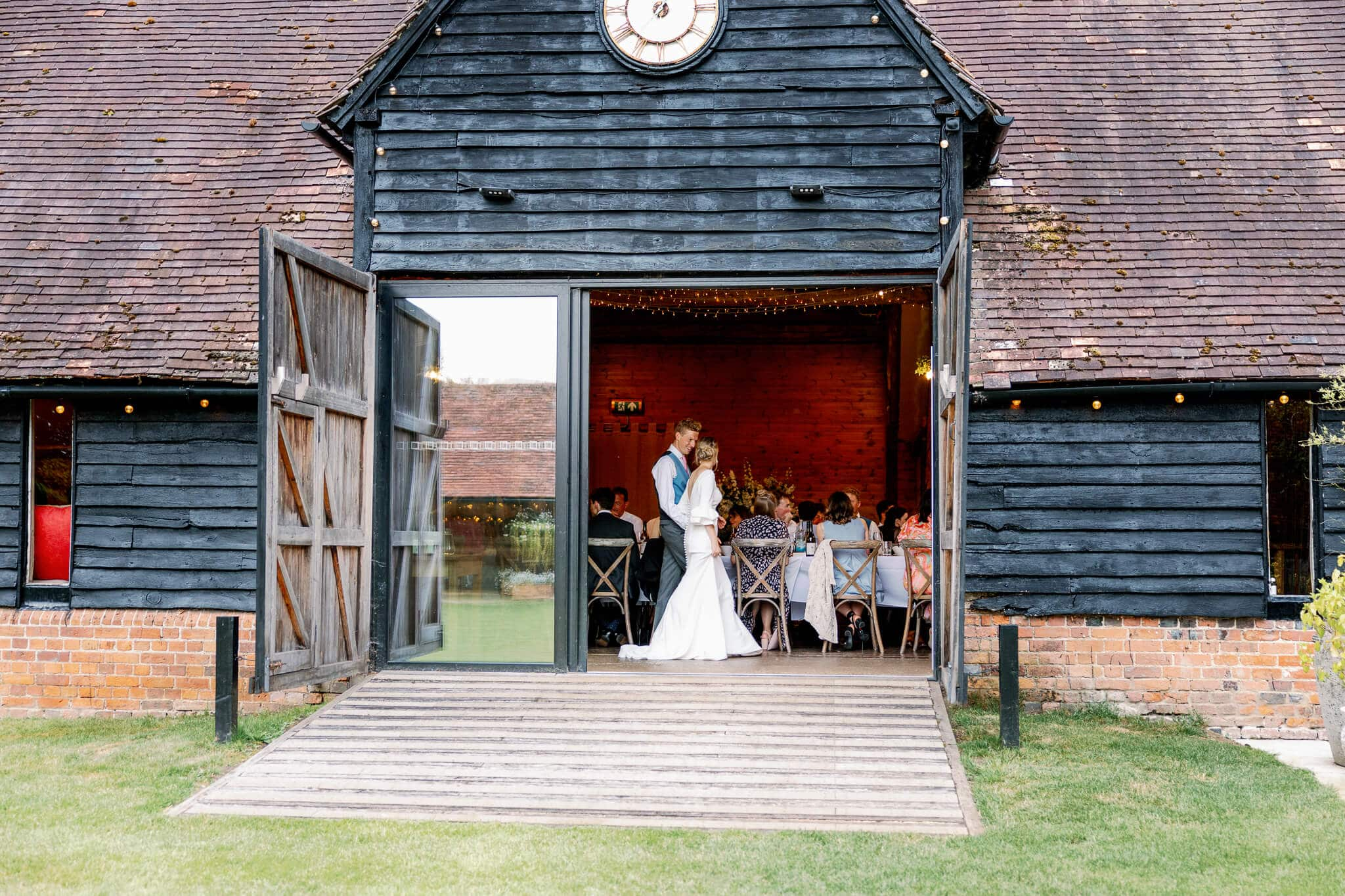 Lains Barn wedding venue with couple in Oxfordshire