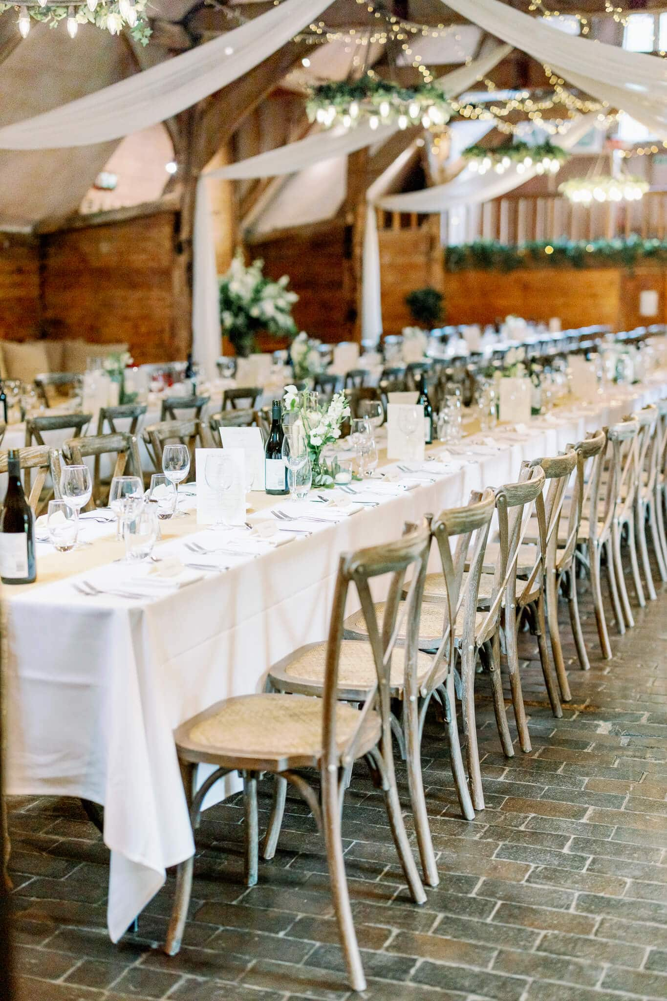 Lains Barns wedding venue with long trestle tables