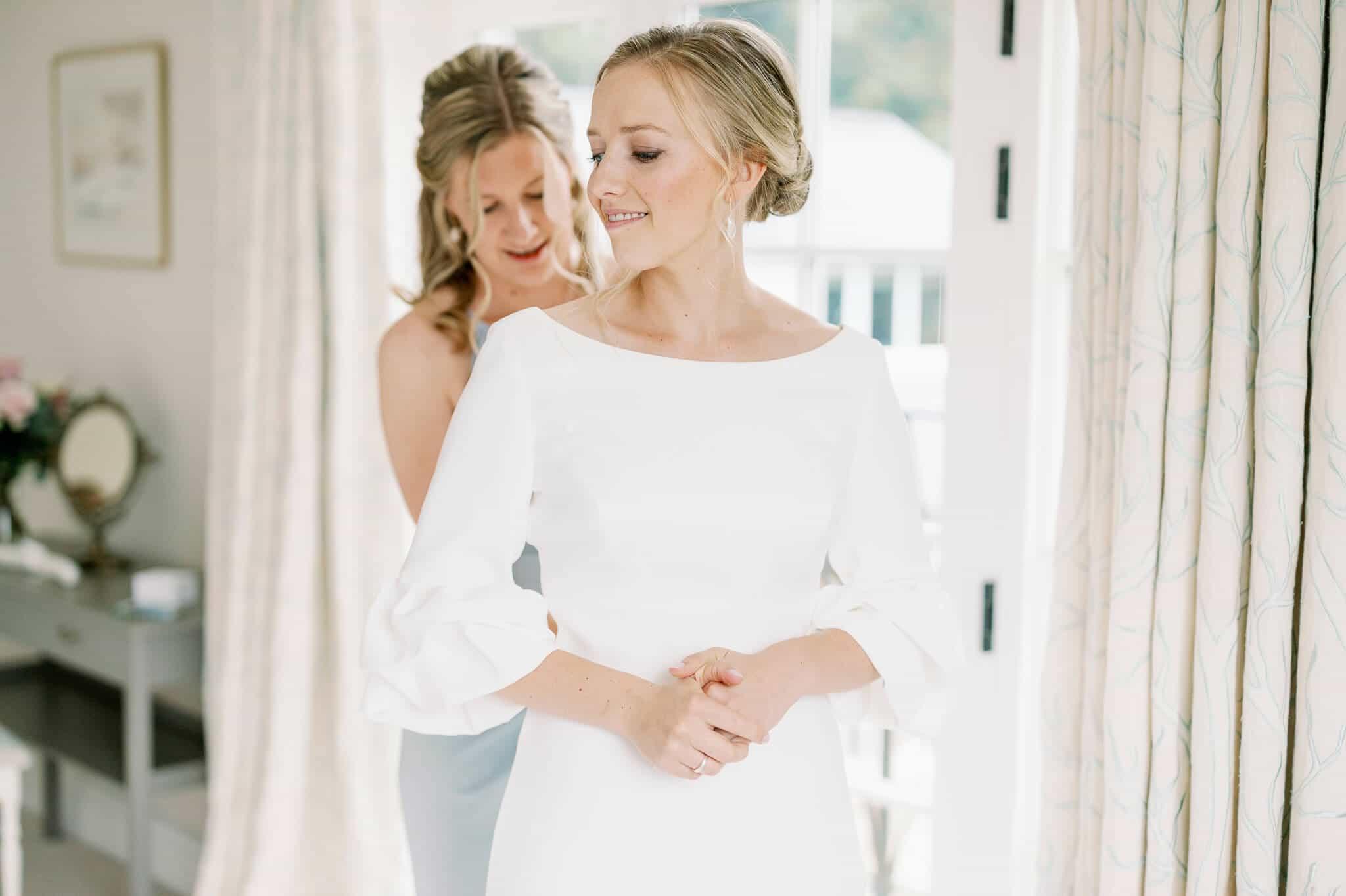 Lains Barn wedding photos of Bride in Suzanne Neville