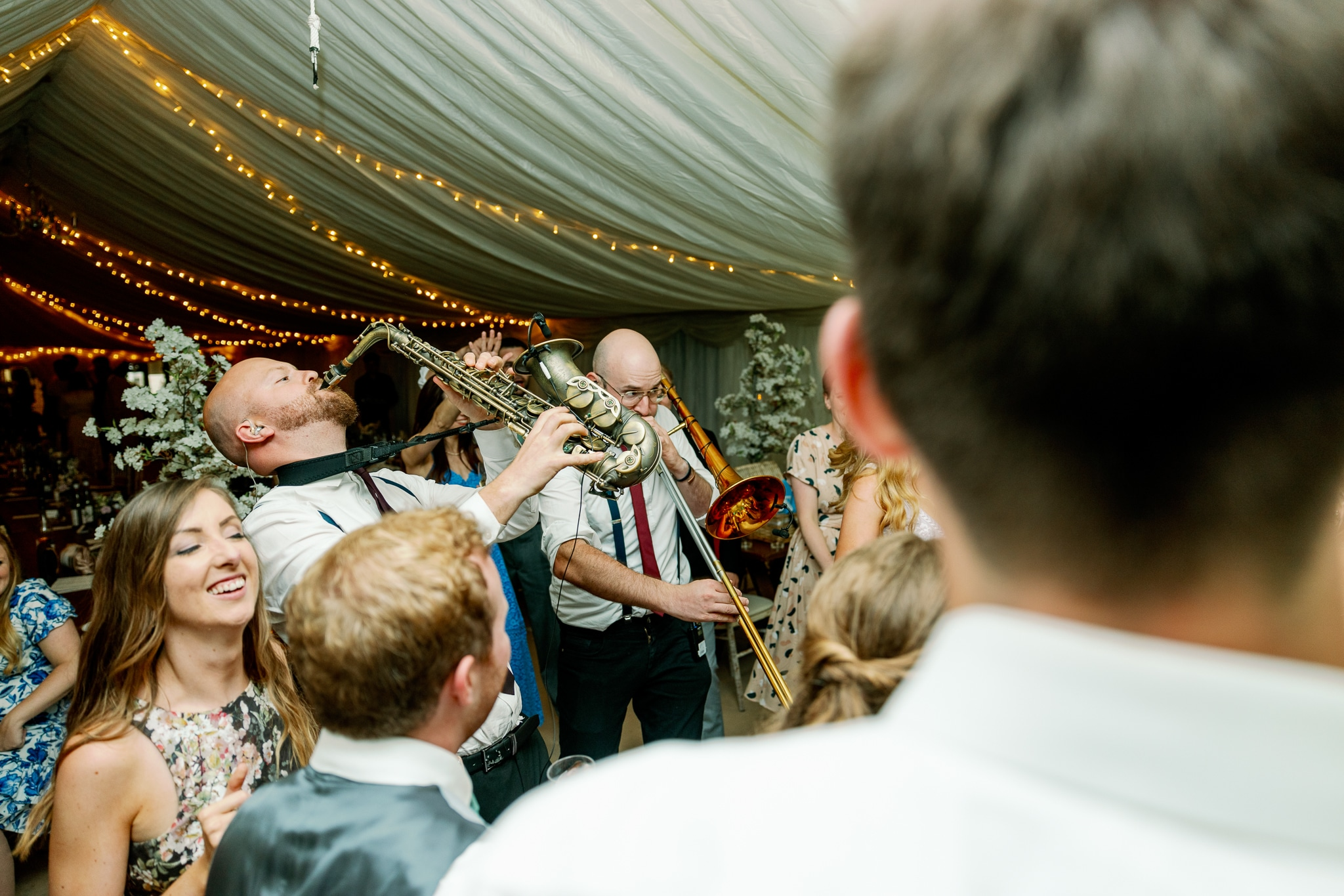 Pandora's Jukebox band on the dance floor with guests in Rye wedding venue