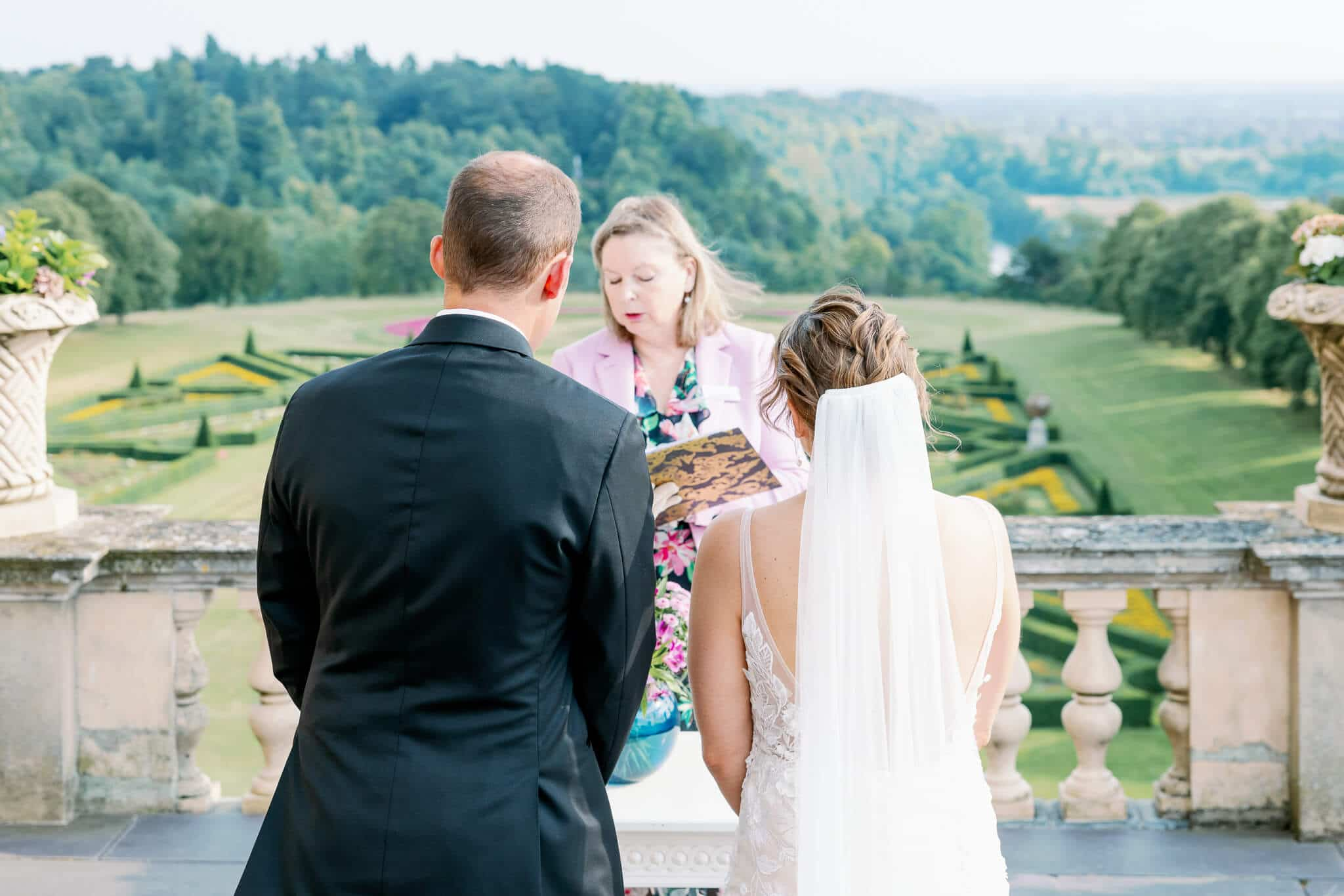 Stunning ceremony view at Cliveden House Hotel first-floor terrace | wedding photography west london