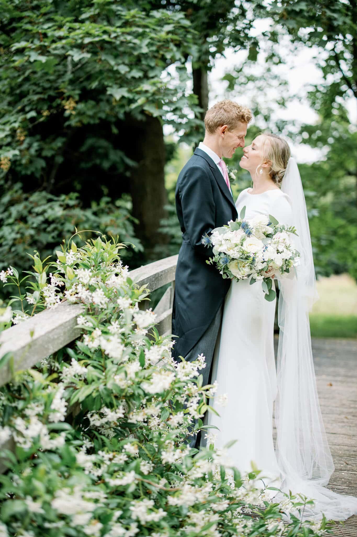 Worcester college wedding photography on bridge
