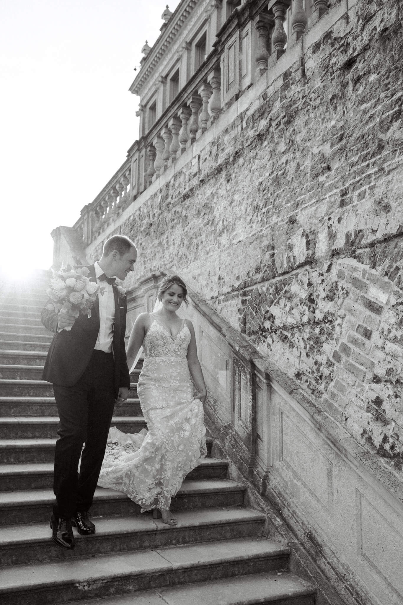 couple walking down stairs |Wedding photography