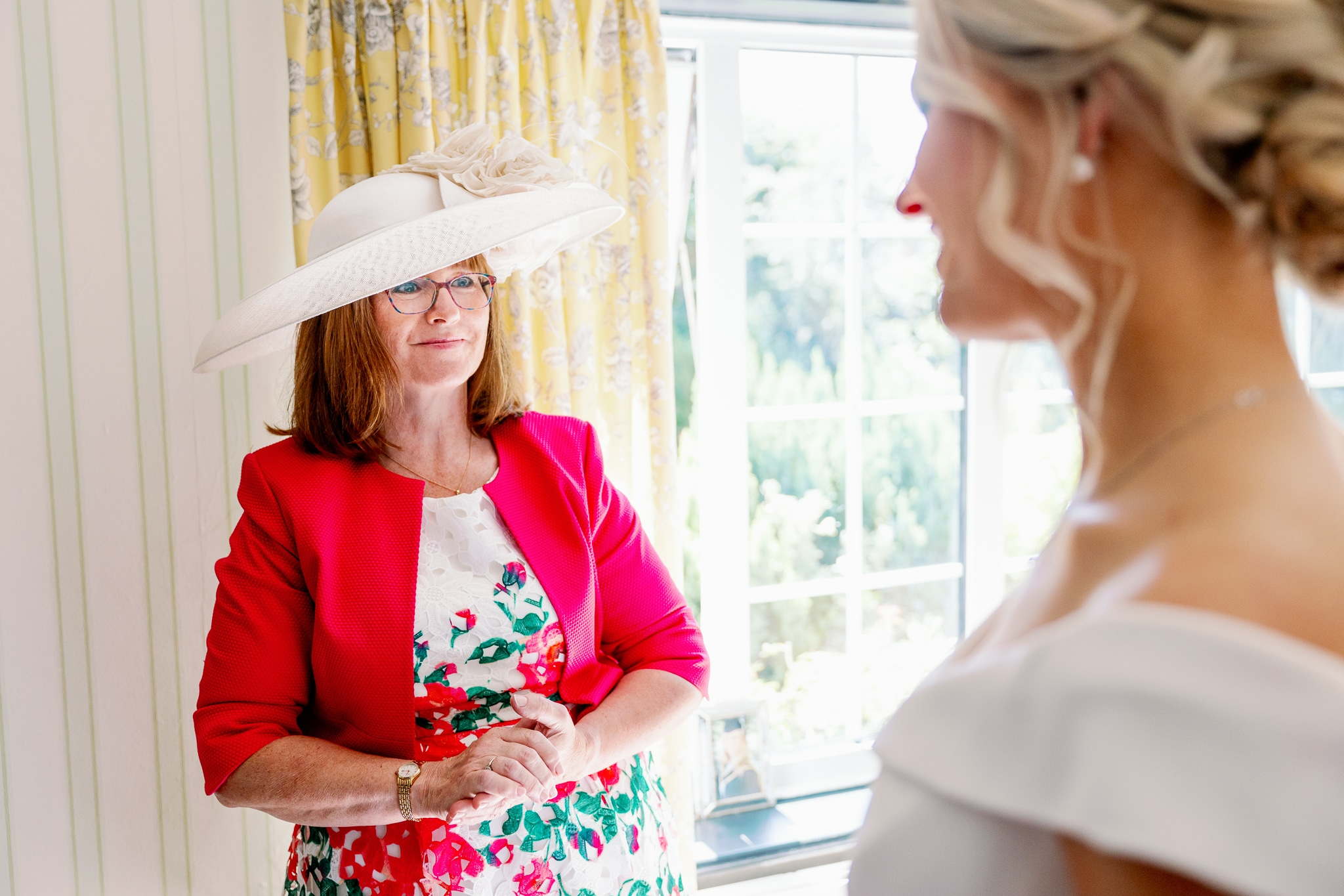mum and bride with wedding photographer in Sussex